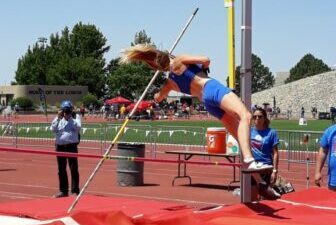 Pole vaulter clearing the bar